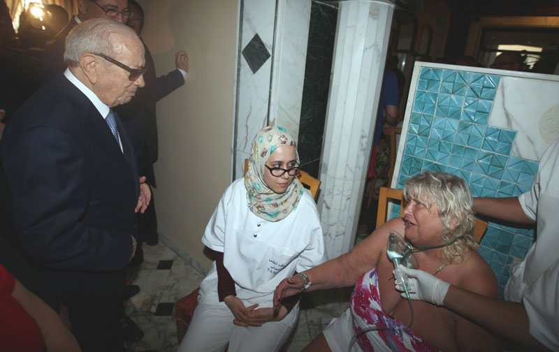 In this photo dated Friday, June 26, 2015, Tunisian President Beji Caid Essebsi, left, visits a survivor of a terrorist attack, right, in an hospital in the costal town of Sousse, Tunisia. Photo: AP
