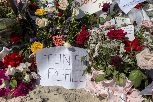 Messages and flowers are placed at the beach of the Imperial Marhaba resort, which was attacked by a gunman in Sousse, Tunisia, June 29, 2015.  REUTERS/Zohra Bensemra