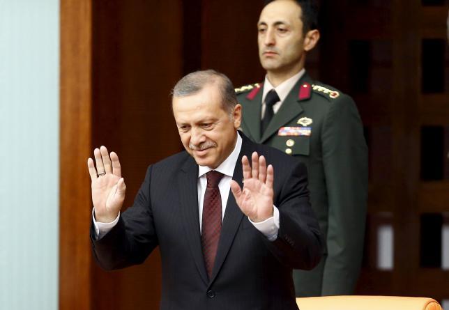 Turkey's President Tayyip Erdogan greets parliamentarians as he arrives at the Turkish parliament to watch a swearing-in ceremony in Ankara, Turkey, June 23, 2015 REUTERS/Umit Bektas