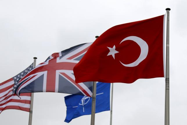 A Turkish flag (R) flies among others flags of NATO members during the North Atlantic Council (NAC) following Turkey's request for Article 4 consultations, at the Alliance headquarters in Brussels, Belgium, July 28, 2015. REUTERS/Francois Lenoir