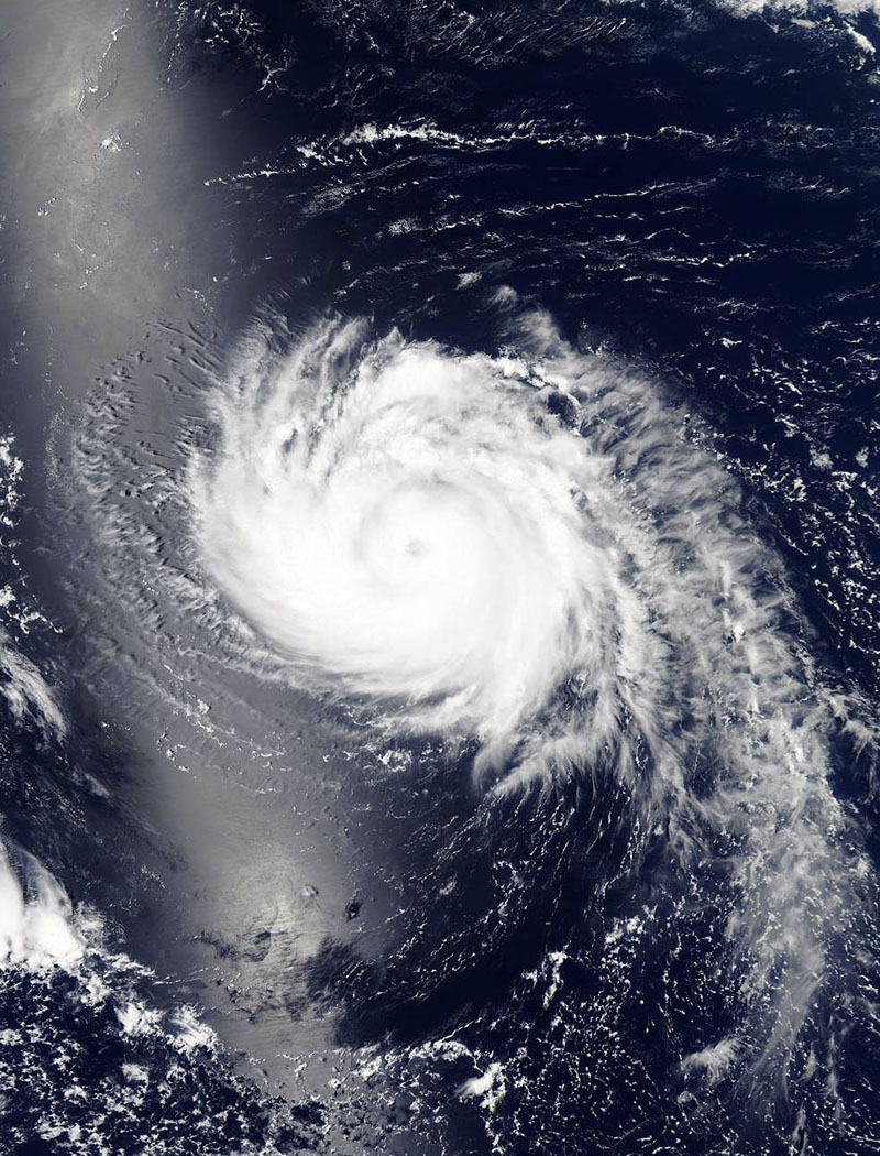 File: This image obtained from NASA shows Typhoon Halola on July 21, 2015, at 03:55 UTC. Halola's path is expected to take the storm to Japan by July 26, 2015, threatening flash flooding, mudslides, and damaging winds. Halola reached maximum sustained winds of 95mph (152kph) July 21.