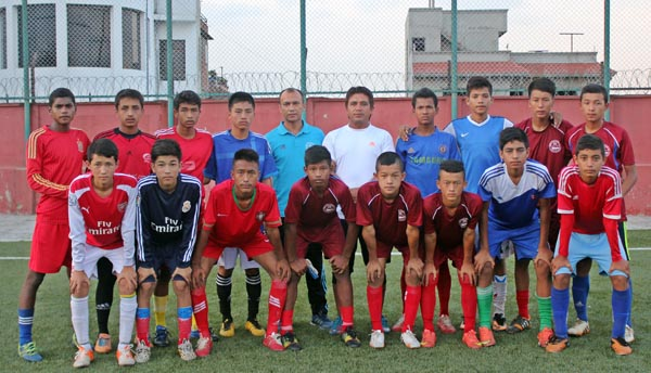 The Under-14  team members pose with coaches after being selected for the All Nepal Football Association Academy in Lalitpur on Friday. Photo: ANFA