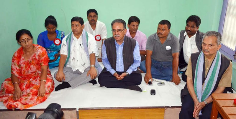 Flank by senior party leaders, UCPN-M Chairman Pushpa Kamal Dahal speaking at a press conference in Birgunj on Saturday, July 11, 2015.