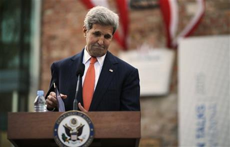 US Secretary of State John Kerry pauses as he delivers a statement to the media on the Iran nuclear talks in Vienna, Austria, July 9, 2015. AP