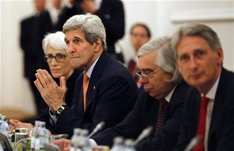 U.S. Secretary of State John Kerry meets with foreign ministers of Germany, France, China, Britain, Russia and the European Union at a hotel in Vienna, Austria, Tuesday, July 7, 2015. AP