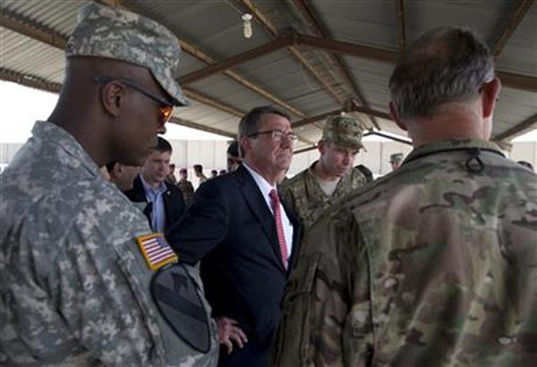 U.S. Defense Secretary Ash Carter, center, stands with Col. Otto Liller, commander, 1st Special Forces Group (Airborne), second from right, as he observes Iraqi Counter Terrorism Service forces participate in a training exercise at the Iraqi Counter Terrorism Service Academy on the Baghdad Airport Complex in Baghdad, Iraq, Thursday, July 23, 2015. Carter is on a weeklong tour of the Middle East focused on reassuring allies about Iran and assessing progress in the coalition campaign against the Islamic State in Syria and Iraq. Photo: AP
