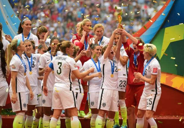 Jul 5, 2015; Vancouver, British Columbia, CAN; United States players react as they receive the FIFA Women's World Cup trophy after defeating Japan in the final of the FIFA 2015 Women's World Cup at BC Place Stadium. Credit: Anne-Marie Sorvin-USA TODAY Sports