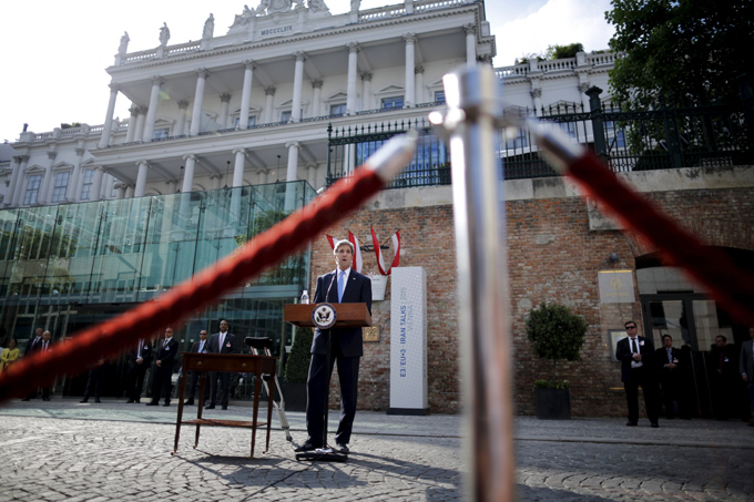 U.S. Secretary of State John Kerry delivers a statement on Cuba outside the hotel where the Iran nuclear talks meetings are being held in Vienna, Austria, July 1, 2015. U.S. President Barack Obama said on Wednesday the U.S. has agreed to the historic step of re-establishing diplomatic relations with Cuba, and will raise its flag over a U.S. Embassy in Havana this summer. REUTERS/Carlos Barria