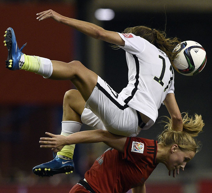 Americau2019s Tobin Heath (top) vies with Germany's Almuth Schult during their 2015 FIFA Women's World Cup semi-final match at the Olympic Stadium in Montreal on Tuesday. Photo: AFP