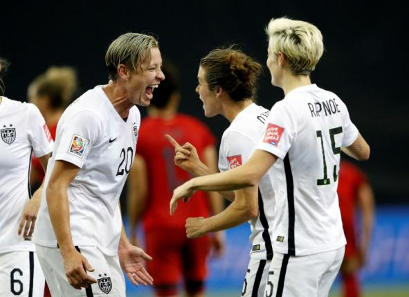 United States defender Kelley O'Hara (5) celebrates with forward Abby Wambach (20) after scoring against Germany during the second half of the semifinals of the FIFA 2015 Women's World Cup at Olympic Stadium. Michael Chow-USA TODAY Sports