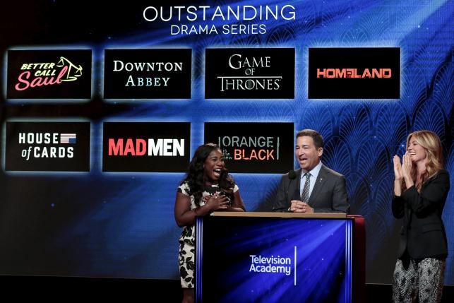 Actresses and nominees Uzo Aduba (L) and Cat Deeley (R) with Television Academy chairman and CEO Bruce Rosenbaum (center) are pictured during the nomination announcements for the 67th Primetime Emmy Awards in West Hollywood, California July 16, 2015.  REUTERS/Jonathan Alcorn