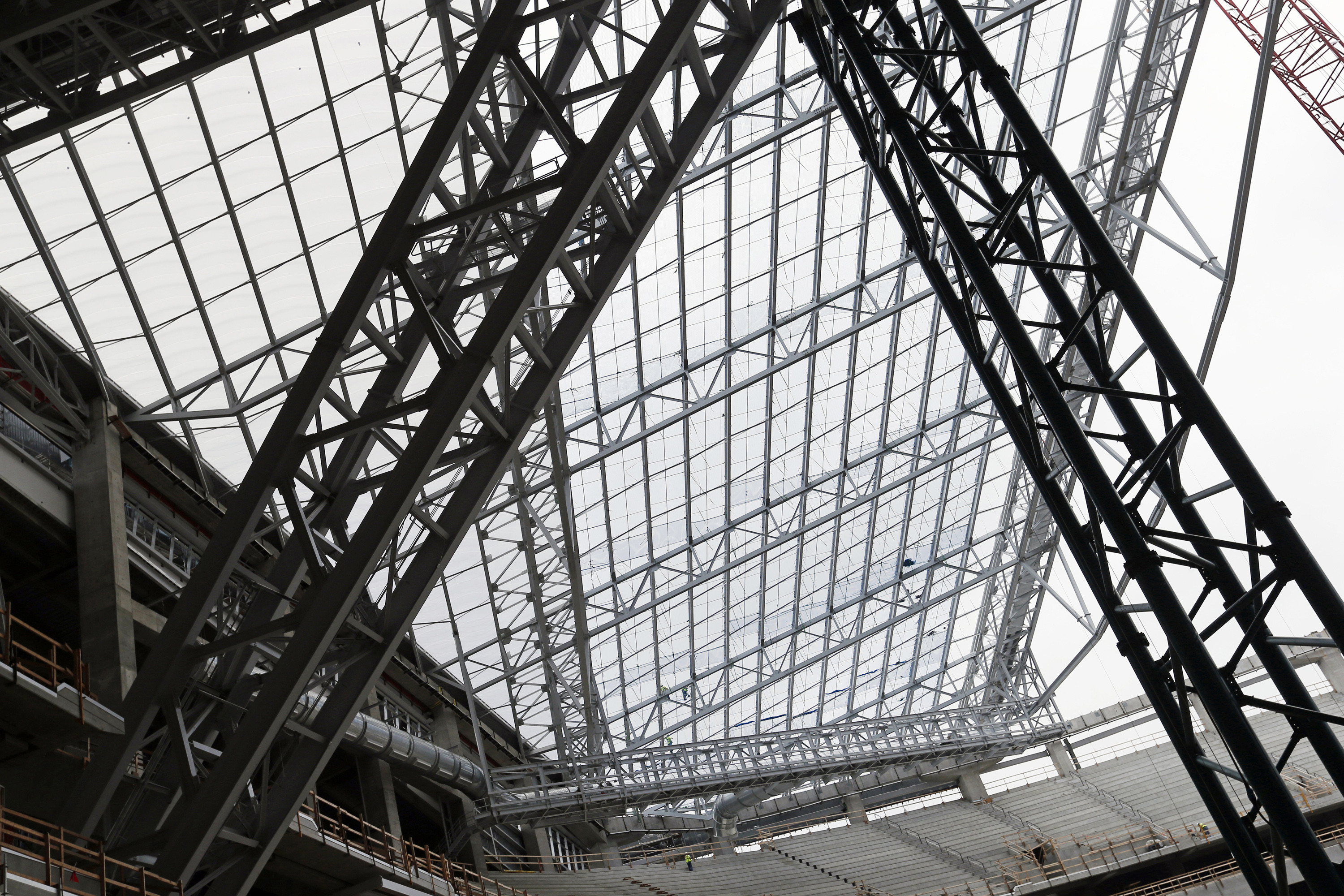 In this photo taken Thursday, July 16, 2015, installed see-through, lightweight EFTE roof panels are visible, upper left triangular section, as the roof takes shape at the new Minnesota Vikings NFL football stadium that is under construction in Minneapolis. The architect chose the alternative roof that will let the light stream in during games and make fans feel closer to being outside. (AP Photo/Jim Mone)