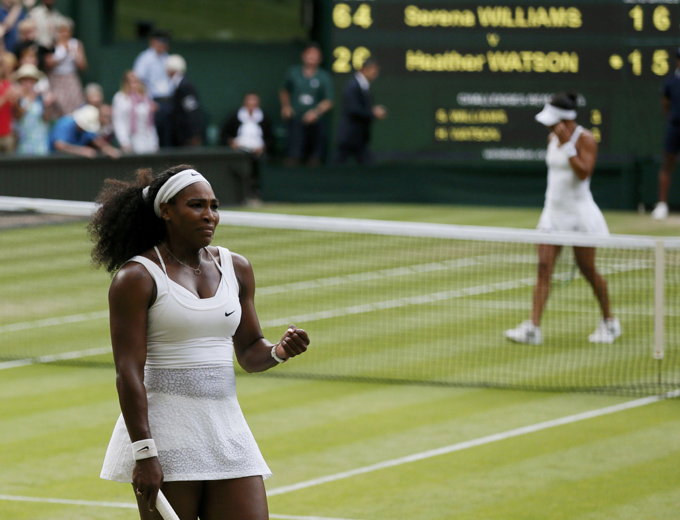 Serena Williams of the U.S.A. celebrates after winning her match against Heather Watson of Britain (R) at the Wimbledon Tennis Championships in London, July 3, 2015.               REUTERS/Stefan Wermuth
