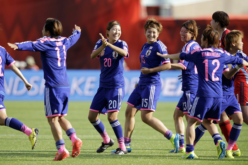 Jul 1, 2015; Edmonton, Alberta, CAN; Japan celebrates after beating England in the semifinals of the FIFA 2015 Women's World Cup at Commonwealth Stadium. Mandatory Credit: Erich Schlegel-USA TODAY Sports
