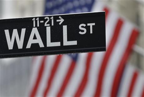 This July 9, 2015 photo shows a Wall Street sign near the New York Stock Exchange in New York. U.S. stocks were mostly lower in early trading Tuesday, July 21, 2015, following weak corporate earnings results from IBM, United Technologies and other big companies. AP