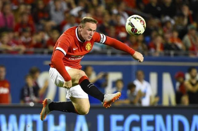 Jul 29, 2015; Chicago, IL, USA; Manchester United forward Wayne Rooney (10) kicks the ball against the Paris Saint-Germain during the second half at Soldier Field. Paris Saint-Germain defeats Manchester United 2-0. Mandatory Credit: Mike DiNovo-USA TODAY Sports