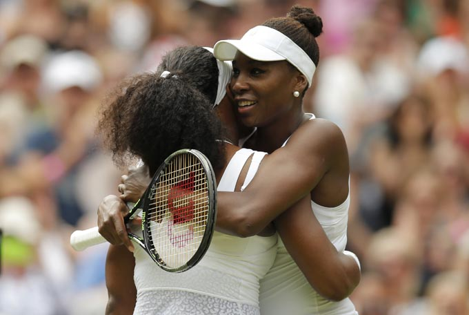 USA's Serena Williams and USA's Venus Williams embrace after their fourth round matchnPhoto: Reuters