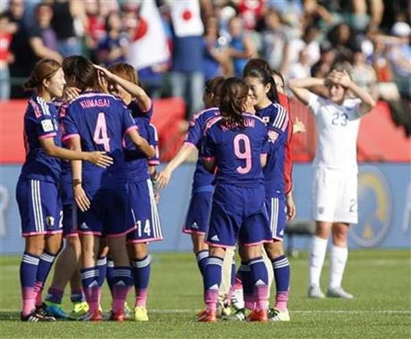 Japan players celebrate a 2-1 win as England's Ellen White (23) watches following a semifinal in the FIFA Women's World Cup soccer tournament, Wednesday, July 1, 2015, in Edmonton, Alberta, Canada. Japan won 2-1. nPhoto:AP
