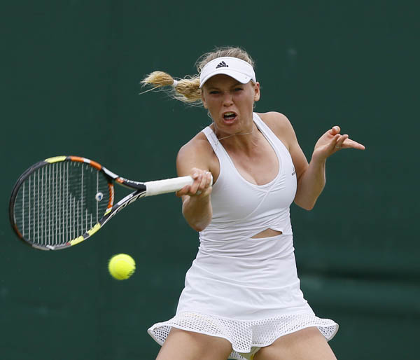 Caroline Wozniacki of Denmark returns to Denisa Allertova of the Czech Republic during their  Wimbledon women singles match in London on Thursday. Wozniacki won 6-1, 7-6 (8/6). Photo: AP