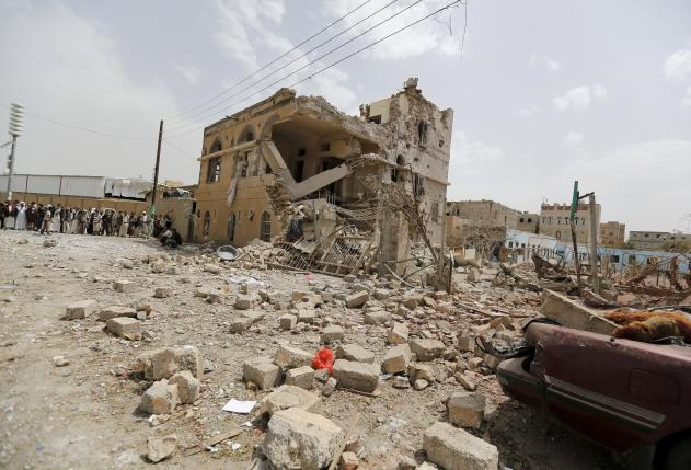 People gather at a site hit by a Saudi-led air strike in Yemen's capital Sanaa July 3, 2015. REUTERS/Khaled Abdullah