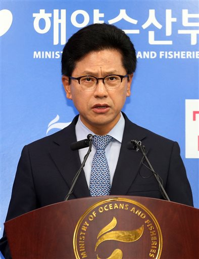 South Korea's Ministry of Oceans and Fisheries official Yeon Yeong-jin speaks during a press conference at the government complex in Sejong, South Korea, Wednesday, July 15, 2015. South Korea on Wednesday selected a Chinese-led consortium as a preferred bidder to salvage a sunken ferry that killed more than 300 people in April last year in one of the country's deadliest disasters in decades.(Bae Jae-man/Yonhap via AP) KOREA OUT
