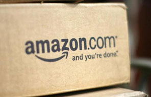 A parcel travels along a conveyer belt at Amazon's new distribution center in Brieselang, near Berlin November 28, 2013. Photo: Reuters/ File
