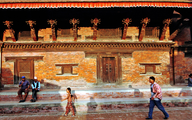 People walking past an ancient site in Patan. Many cultural heritages were ravaged in the April 25 earthquake and subsequent aftershocks. Photo: THT