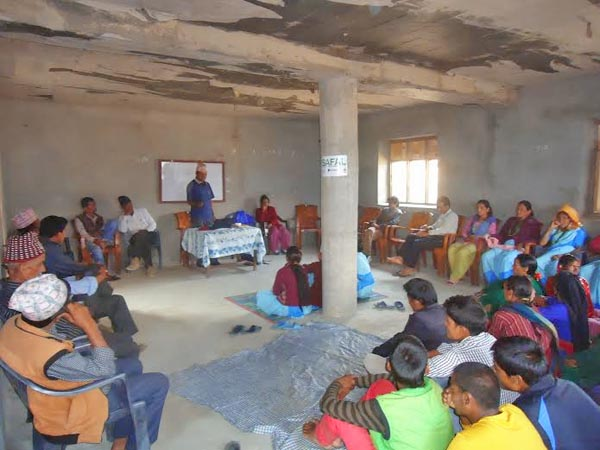 Political parties, social worker, teachers, and HIV- infected people participating in a programme to discuss about the fund in Barbisha VDC office in  Bajura district on Thursday, July 2, 2015.nPhoto: Prakash Singh