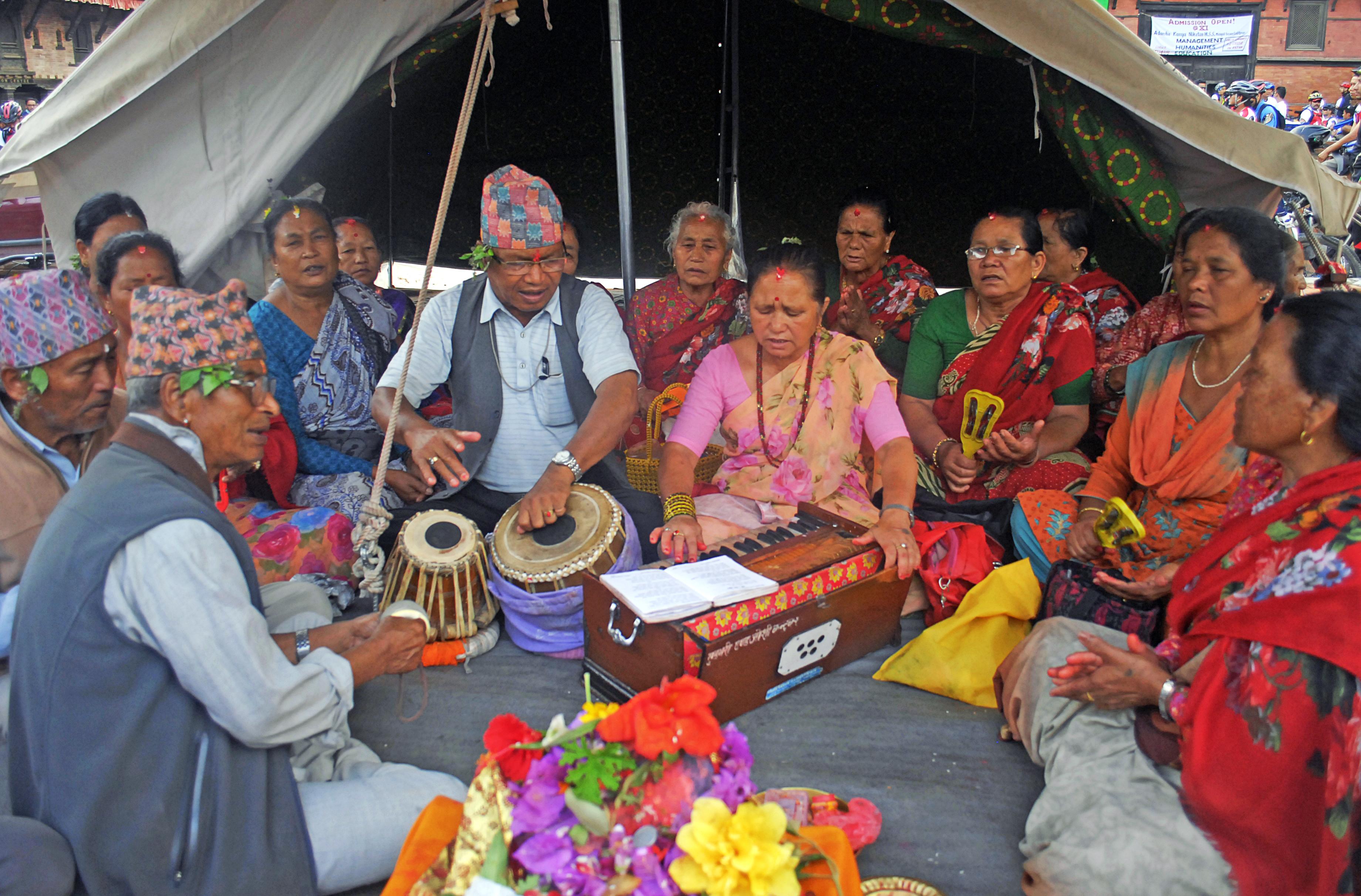 Devotees singing bhajan at Mangalbazar, in Lalitpur, on Monday. Photo: THT