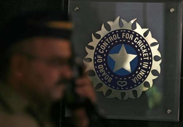 A policeman walks past a logo of the Board of Control for Cricket in India (BCCI) during a governing council meeting of the Indian Premier League (IPL) at BCCI headquarters in Mumbai April 26, 2010.  Photo: Reuters