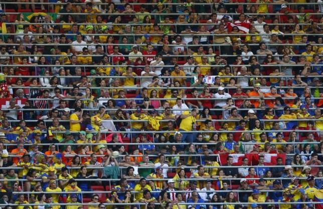 File- Spectators watch the  2014 World Cup Group E soccer match between Switzerland and Eduador at the Brasilia national stadium in Brasilia, June 15, 2014.  Photo: Reuters