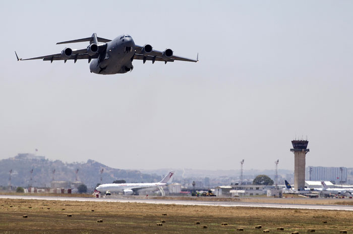 A British Royal air force plane takes off from the Tunis military airport, in the Tunisian capital, on July 1, 2015, transporting coffins containing the bodies of British victims of a beach attack by a jihadists gunman in Sousse the previous week. Photo: AFP