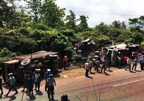 Security personnel and locals gather at the site of bus-truck collision at Daunne in Nawalparasi on Friday.   Photo:THT