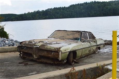 This photo provided by the Caldwell County Sheriffu2019s Office shows a 1968 Pontiac Catalina that was pulled from Lake Rhodhiss in North Carolina on Tuesday July 21, 2015. AP