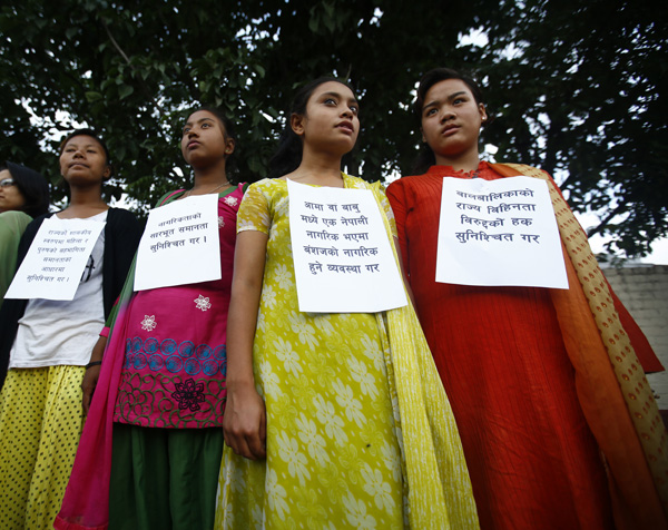 Participants staging a protest with banners on their chests to demand that the constitution must ensure citizenship can be transferred to children through mothers, in Babarmahal, on Wednesday. Photo: THT