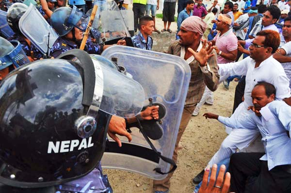 Madhesi leaders clash with cops while trying to obstruct the public hearing on draft constitution in Birgunj, on Monday. Madhesi leaders claim that the draft is anti-Madhes. Photo: Ram Saraf/THT