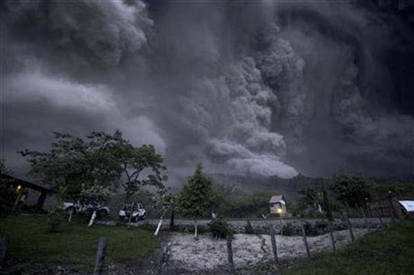 Clouds of ash fill the sky after an eruption by the Colima volcano, known as the Volcano of Fire, near the town of Comala, Mexico, Friday, July 10, 2015. The volcano spewed ash more than 4 miles (7 kilometers) into the air and released some quantity of lava. People were advised to recognize a 3-mile (5-kilometer) perimeter around the peak. Photo: AP