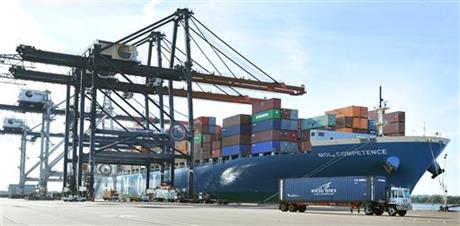 In this Jan. 6, 2015 photo, the MOL Competence, a 1036-foot long, 150-foot wide container ship carrying 45,000 tons of cargo, is moored at the TraPac Container Terminal in Jacksonville, Fla. The Commerce Department reports on the U.S. trade gap for May 2015 on Tuesday, July 7, 2015. AP