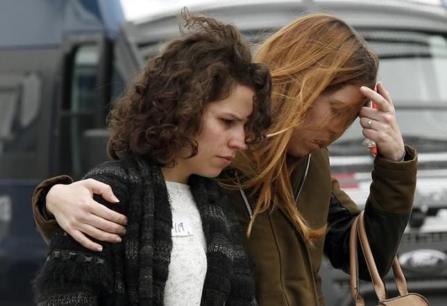 Family members of passengers feared killed in Germanwings plane crash react at Barcelona's El Prat airport March 24, 2015. REUTERS/Gustau Nacarino/Files