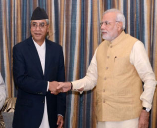 Indian Prime Minister Narendra Modi shaking hands with senior leader of the Nepali Congress Sher Bahadur Deuba during a meeting held in Hotel Hyatt in Kathmandu during Modi's Nepal visit on Monday, August 4, 2014. Photo: THT/File n