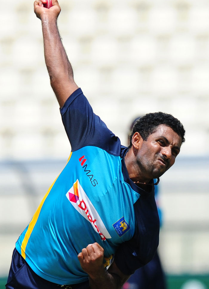 Sri Lankau2019s Dhammika Prasad delivers during a practice session at the Pallekele International Cricket Stadium in Pallekele on Thursday. Photo: AFP