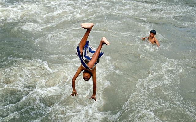A boy diving into the Bagmati River in Thapathali, Kathmandu, on Saturday. Photo: Skanda Gautam/ THT