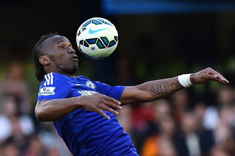 FILES - A picture taken on April 18, 2015 shows Chelsea's Ivorian striker Didier Drogba controlling the ball during the English Premier League football match between Chelsea and Manchester United at Stamford Bridge in London. Former Chelsea star Didier Drogba joined Major League Soccer's Montreal Impact on July 27, 2015, the Ivory Coast striker signing with the Canadian club after a rights transfer from the Chicago Fire. AFP PHOTO / BEN STANSALLnnnnRESTRICTED TO EDITORIAL USE. No use with unauthorized audio, video, data, fixture lists, club/league logos or u0093liveu0094 services. Online in-match use limited to 45 images, no video emulation. No use in betting, games or single club/league/player publications.