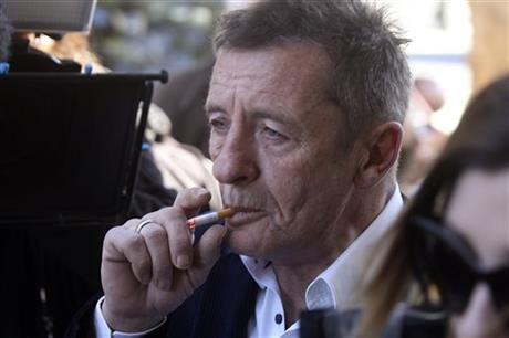 Former AC/DC drummer Phil Rudd arrives for sentencing at the Tauranga District Court in Tauranga, New Zealand, Thursday, July 9, 2015. AP