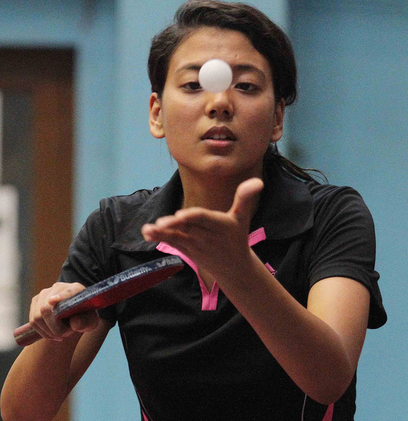 Elina Maharjan of Nepal Police Club serves to Anita Maharjan of Nepal APF Club during women's singles match at the National Open Table Tennis Tournament in Kathmandu on Thursday. Photo: THT