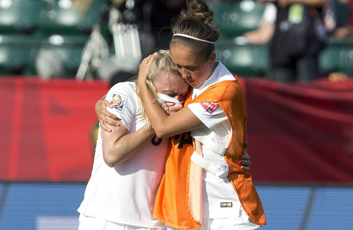 England's Josanne Potter, right, consoles Laura Bassett (6) after a 2-1 loss to Japan in a semifinal in the FIFA Women's World Cup soccer tournament, Wednesday, July 1, 2015, in Edmonton, Alberta, Canada. Photo: AP