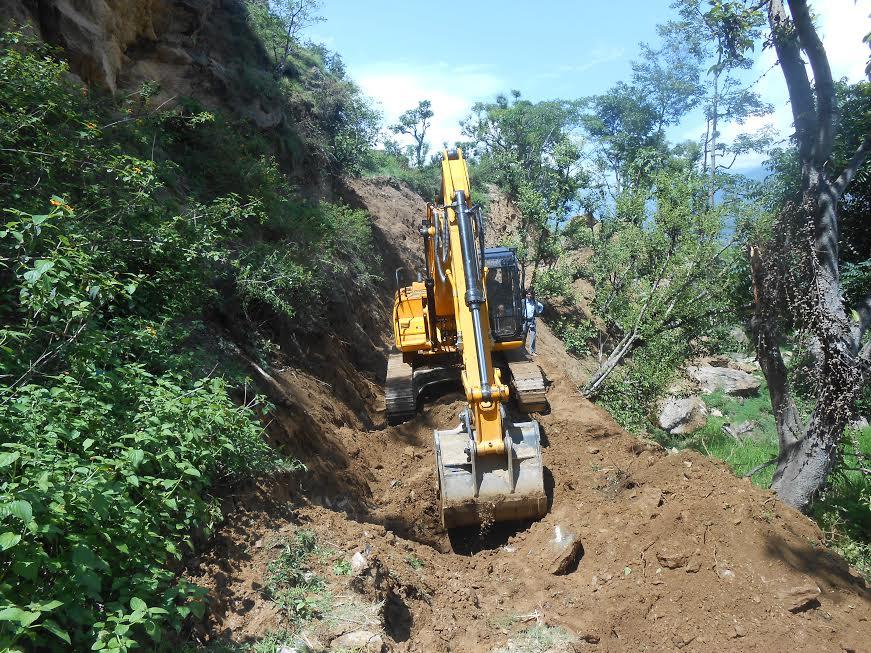 An excavator opening a trail along the under-construction Barhabis-Kanda road section of Bajura on Sunday, July 12, 2015. Photo: Prakash Singh