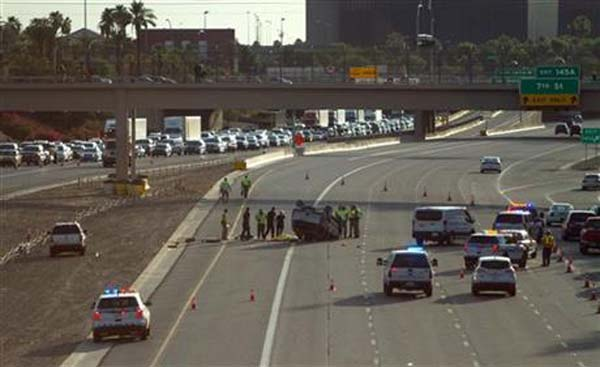 Traffic backs up on Interstate 10 as authorities investigate the scene of a fatal accident on Sunday, July 26, 2015, in Phoenix. Multiple people were killed in the rollover crash and several were injured. Photo: AP