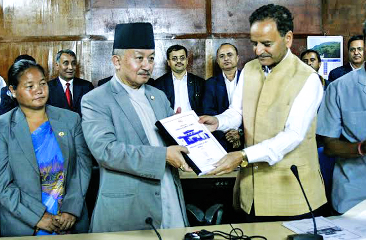 Constituent Assembly Chairman Subas Chandra Nembang receiving the first draft of new constitution from Constitution Drafting Committee Chairman Krishna Prasad Sitaula during a function in Singha Durbar on Tuesday. Photo: THT