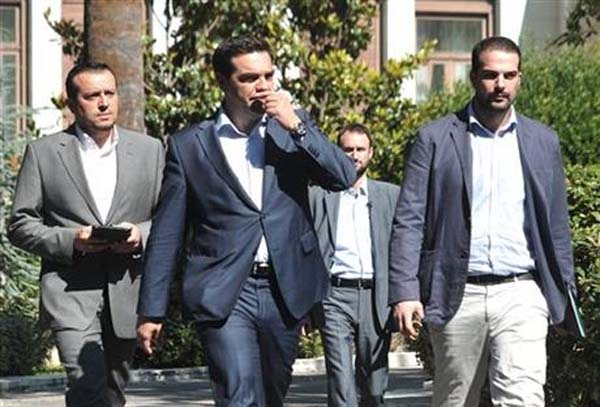 Greece's Prime Minister Alexis Tsipras, center, leaves after a meeting with Greek political party leaders at the Presidential Palace as Minister of State Nikos Pappas, left, and Government spokesman Gabriel Sakellaridis, right, follow him in Athens, Monday, July 6, 2015. Greece and its membership in Europe's joint currency faced an uncertain future Monday, with the country under pressure to reach a bailout deal with creditors as soon as possible after Greeks resoundingly rejected the notion of more austerity in exchange for aid. Photo: AP